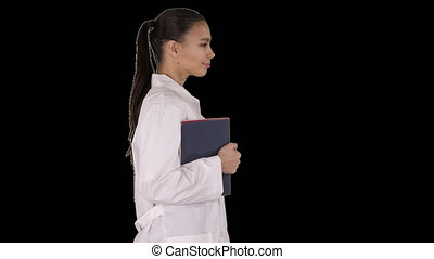Happy smiling female doctor walking holding notebooks or documents, Alpha Channel
