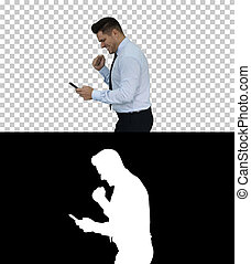 Happy business man walking in frame using mobile phone and then