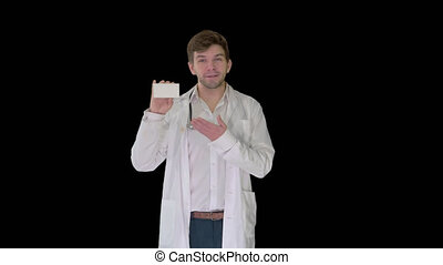 Walking Male Doctor showing empty white box of pills, Alpha ...