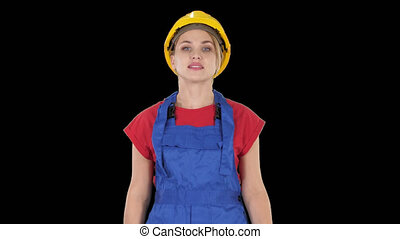 On Alpha Matte. Medium shot. Young woman in yellow hardhat walking, Alpha Channel Professional shot in 4K resolution. 006. You can use it e.g. in your commercial video, business, presentation, broadcast