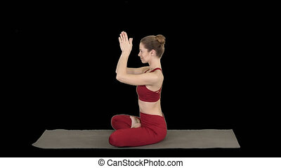 Young sporty attractive woman practicing yoga, doing Lotus pose, Alpha Channel