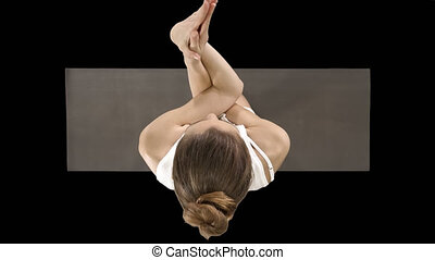 Attractive girl standing in the balancing yoga pose Garudasana Young woman in the Eagle yoga pose, Alpha Channel