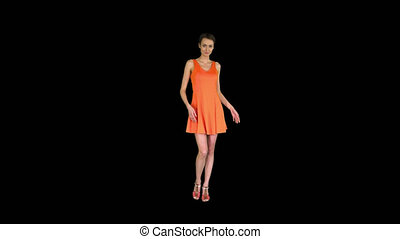 On Alpha Matte. Wide shot. A beautiful, cheerful woman straightens her dress, Alpha Channel. Professional shot in 4K resolution. 023. You can use it e.g. in your commercial video, business, presentation, broadcast