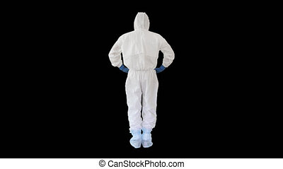 On Alpha Matte. Wide shot. Back view. Man in a white decontamination suit putting hand on his head Bad situation, Alpha Channel. Professional shot in 4K resolution. 53. You can use it e.g. in your medical, commercial video, business, presentation, broadcast