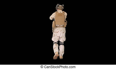 On Alpha Matte. Wide shot. Back view. Ranger in full combat uniform walking, Alpha Channel. Professional shot in 4K resolution. 4151. You can use it e.g. in your commercial video, business, presentation, broadcast