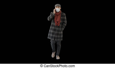 On Alpha Matte. Wide shot. Fashionable gentleman in medical mask calling on the phone, Alpha Channel. Professional shot in 4K resolution. 53. You can use it e.g. in your medical, commercial video, business, presentation, broadcast