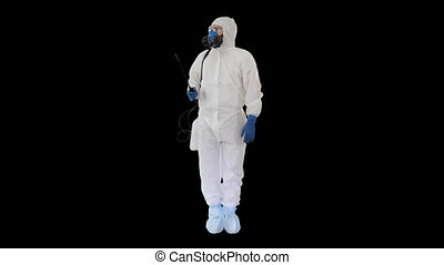 On Alpha Matte. Wide shot. Man in a protective suit and mask holding a disinfectant ready to work, Alpha Channel. Professional shot in 4K resolution. 53. You can use it e.g. in your medical, commercial video, business, presentation, broadcast