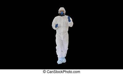 On Alpha Matte. Wide shot. Man in hazamat suit walking and dancing Covid-19 concept, Alpha Channel. Professional shot in 4K resolution. 53. You can use it e.g. in your medical, commercial video, business, presentation, broadcast
