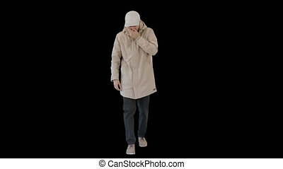 On Alpha Matte. Wide shot. Man in winter outfit walking and coughing, Alpha Channel. Professional shot in 4K resolution. 53. You can use it e.g. in your medical, commercial video, business, presentation, broadcast