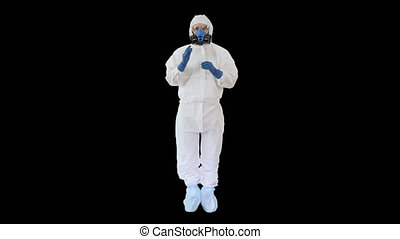 On Alpha Matte. Wide shot. Man Wearing HAZMAT Protective Clothing Showing That He Wears Gloves, Alpha Channel. Professional shot in 4K resolution. 53. You can use it e.g. in your medical, commercial video, business, presentation, broadcast