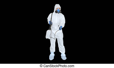 Man wearing personal protective equipment (ppe) suit ...