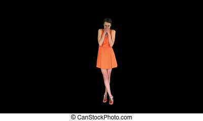 On Alpha Matte. Wide shot. Shocked or surprised young woman in orange sundress, Alpha Channel. Professional shot in 4K resolution. 023. You can use it e.g. in your commercial video, business, presentation, broadcast