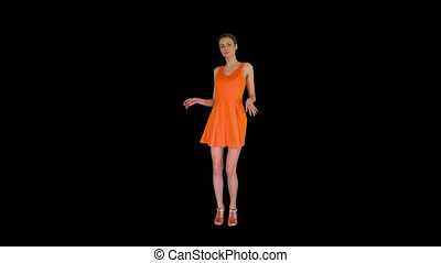 On Alpha Matte. Wide shot. Short-haircutted pretty woman dancing in orange sundress, Alpha Channel. Professional shot in 4K resolution. 023. You can use it e.g. in your commercial video, business, presentation, broadcast