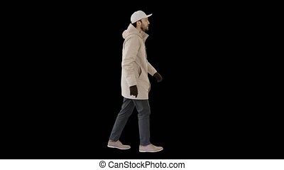 Handsome fashionable man in a winter stylish coat walking, Alpha Channel