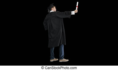 Man in graduation gown posing for the camera, Alpha Channel...