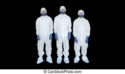On Alpha Matte. Wide shot. Three doctors in protective clothes fold hands Team work, Alpha Channel. Professional shot in 4K resolution. 53. You can use it e.g. in your medical, commercial video, business, presentation, broadcast