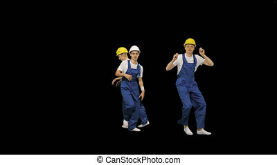 Group of builders walk in the frame and dance, Alpha Channel