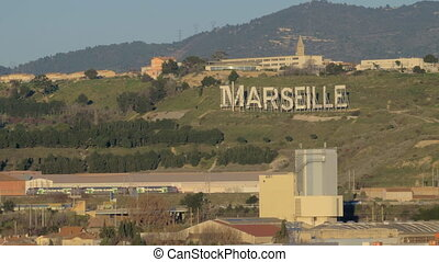 On approach to Marseille - Suburb Marseille hills with huge...
