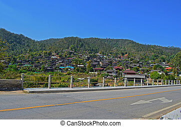 On Asphalt Road pass Country Village 1 2, Bridge, Blue Sky, Direction, Traffic Sign, Maehongson province, Thailand