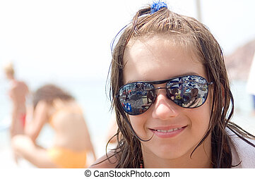 On beach - Young girl child with sunglasses on the beach