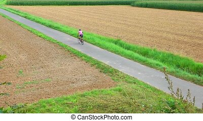On Bicycle in the Field