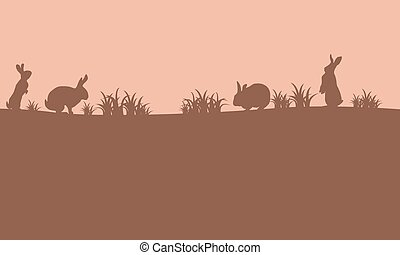On brown background easter bunny silhouettes