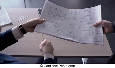 On desk man approves the construction project and signs a...