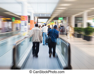 on escalator - people are moving to their gates at the ...