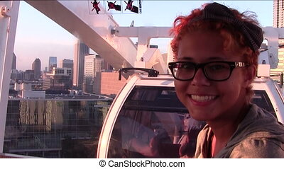On Ferris Wheel - Teen girl inside Ferris wheel gondola