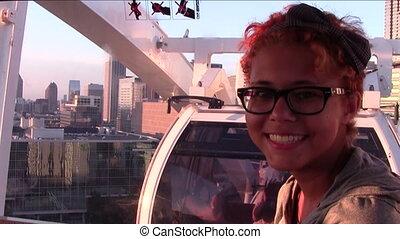 On Ferris Wheel - Teen girl inside Ferris wheel gondola