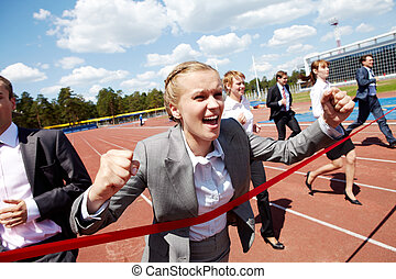 On finish - Photo of happy businesswoman crossing finish...
