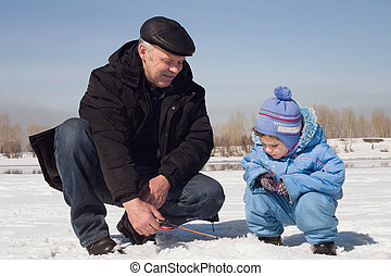 On fishing - The boy, the child with the father on on winter...