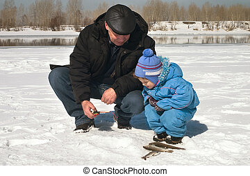 On fishing - The boy, the child with the father on winter ...