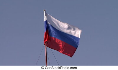 On flagpole flying flag of Russian Federation