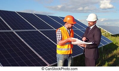 On footage customer telling foreman his wishes regarding construction of solar panels.
