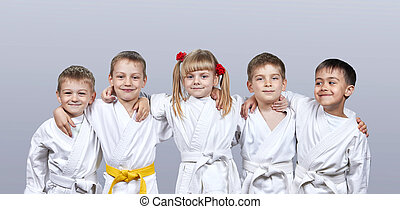 On gray background little athletes - On a gray background...