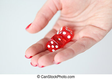 On hand are red dice with white marks