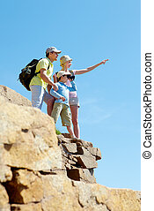 On high mountain - Portrait of family members looking afar ...