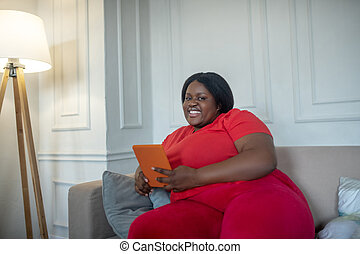 Plus size african american woman spending time on internet