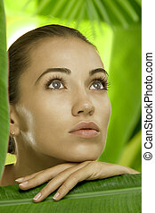 on leaf - portrait of young beautiful woman on green leafs...