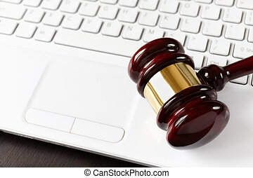 on-line auction - gavel on white laptop, selective focus on...
