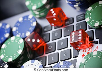 On line - Casino chips, cards and dices stacking on a laptop