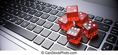 On line - Dices group stacking on a laptop