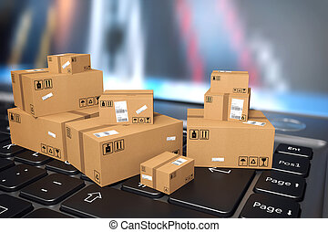 On line shipment - Brown small boxes on a computer keyboard
