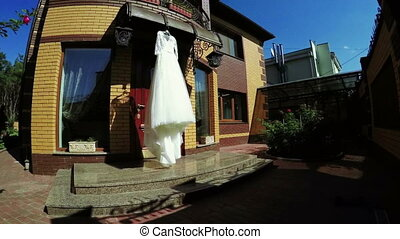 On nature wedding dress - On home hanging wedding dress