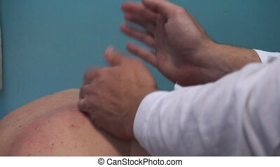 on reception at the masseur. Masseur doing massage to her patient