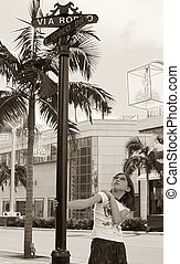 Girl by Rodeo Drive street sign (Beverly Hills)