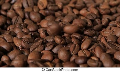 On sacking coffee beans are still falling grains of coffee. Slow motion