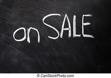 On sale written on blackboard
