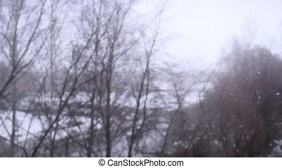 On snow-covered the street during a snowfall in slowmotion. Changes focus to forward in blurred. 1920x1080